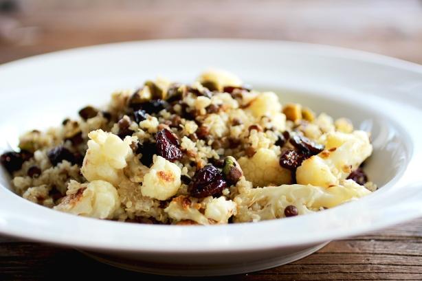 quinoa lentil pilaf  with roasted cauliflower, pistachios + cranberries