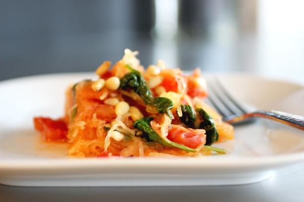 spaghetti squash with tomato, spinach, garlic + pine nuts